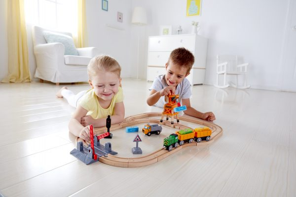 Kids play with MUtable Crossing & Crane Set by Hape Toys